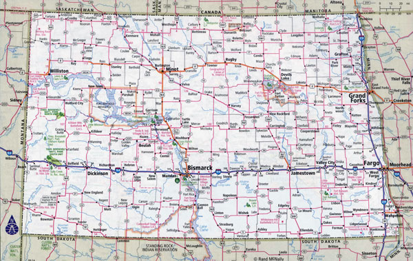 Large detailed roads and highways map of North Dakota state with national parks and cities.